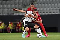 Matthias Jörgensen (Dänemark, Denmark) klammert Kevin Volland (Deutschland Germany) - Innsbruck 02.06.2021: Deutschland vs. Daenemark, Tivoli Stadion Innsbruck