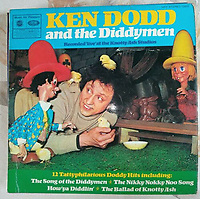 BNPS.co.uk (01202 558833)<br /> Pic: DerekPlant/BNPS<br /> <br /> Pictured: The rare Beatles record fell out of this Ken Dodd and the Diddymen<br /> <br /> Beatles fan tickled by Ken Dodd find...<br /> <br /> An extremely rare recording of a Beatles song that was saved from the tip after it fell out of a Ken Dodd record sleeve has sold for £6,000.<br /> <br /> The original demo version of the White Album track 'Happiness is a Warm Gun' was unwittingly bought in a box of old records at a boot fair 40 years ago by the late Harry Plant.<br /> <br /> He didn't realise the 7ins acetate demo recording, that differs significantly to the final version used on the 1968 album, was in the box.