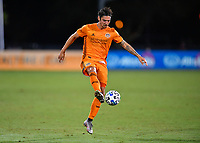 LAKE BUENA VISTA, FL - JULY 18: Zarek Valentin #4 of the Houston Dynamo settles a pass during a game between Houston Dynamo and Portland Timbers at ESPN Wide World of Sports on July 18, 2020 in Lake Buena Vista, Florida.