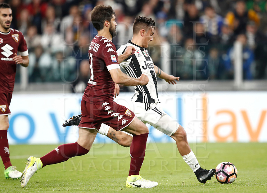 Calcio, Serie A: Torino, Juventus Stadium, 6 maggio 2017. <br /> Juventus' Paulo Dybala (r) in action with Torino's Luca Rossettini (l) during the Italian Serie A football match between Juventus and Torino at Torino's Juventus stadium, May 6, 2017.<br /> UPDATE IMAGES PRESS/Isabella Bonotto