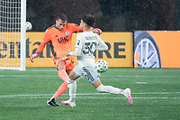 FOXBOROUGH, MA - NOVEMBER 1: Matt Turner #30 of New England Revolution kicks the ball downfield under pressure from Kevin Paredes #30 of DC United during a game between D.C. United and New England Revolution at Gillette Stadium on November 1, 2020 in Foxborough, Massachusetts.