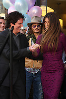 LOS ANGELES - APR 1:  Rob Marshall, Johnny Depp, Penelope Cruz  at the Penelope Cruz Hollywood Walk of Fame Ceremony at El Capitan Theater on April 1, 2011 in Los Angeles, CA