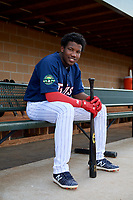 Elizabethton Twins designated hitter Yunior Severino (22) poses for a photo in the dugout before a game against the Bristol Pirates on July 28, 2018 at Joe O'Brien Field in Elizabethton, Tennessee.  Elizabethton defeated Bristol 5-0.  (Mike Janes/Four Seam Images)
