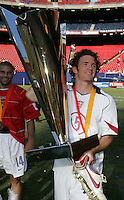 July 24, 2005: East Rutherford, NJ, USA:  USMNT midfielder John O'Brien (5) shows off the trophy after winning the CONCACAF Gold Cup at Giants Stadium.  The USMNT won 3-1 on penalty kicks.
