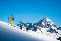 The Ortler Group in northern Italy is a popular region for spring ski touring using the huts for overnights to ski all the many peaks in the mountain group. Ski touring with the Gran Zebru/Königspitze in the background.