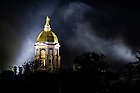 October 13, 2021; Spot lights illuminate the Golden Dome and morning fog before sunrise. (Photo by Barbara Johnston/University of Notre Dame)