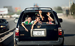 8 June 2013, Mazar-i-Sharif, Balkh Province, Afghanistan. Local kids in the back of a car in downtown Mazar-i-Sharif. Picture by Graham Crouch/World Bank