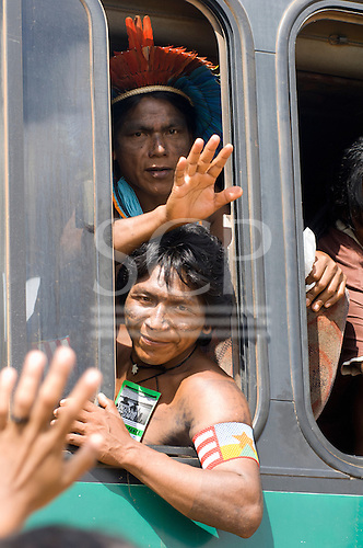 """Altamira, Brazil. """"Xingu Vivo Para Sempre"""" protest meeting about the proposed Belo Monte hydroeletric dam and other dams on the Xingu river and its tributaries. The Kayapo warriors from Pukararankre leave in the bus."""