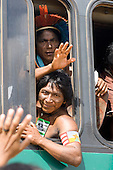 "Altamira, Brazil. ""Xingu Vivo Para Sempre"" protest meeting about the proposed Belo Monte hydroeletric dam and other dams on the Xingu river and its tributaries. The Kayapo warriors from Pukararankre leave in the bus."