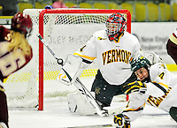 16 October 2010: University of Vermont Catamount goaltender Roxanne Douville, a Freshman from Beloeil, Quebec, makes a save against the Boston College Eagles at Gutterson Fieldhouse in Burlington, Vermont. The Lady Cats fell to the visiting Eagles 4-1 in the second game of their weekend series. Mandatory Credit: Ed Wolfstein Photo