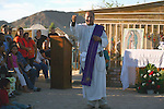 Priest serves outdoor Mass during the Day of the Dead observation