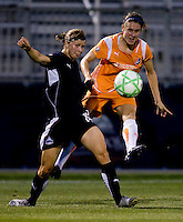 Washington Freedom midfielder (19) Rebecca Moros tries to defend against the shot of  Sky Blue FC midfielder (9) Heather O'Reilly at the Maryland SoccerPlex in Boyds, Maryland.  The Washington Freedom defeated Sky Blue FC, 3-1, to secure a place in the playoffs.