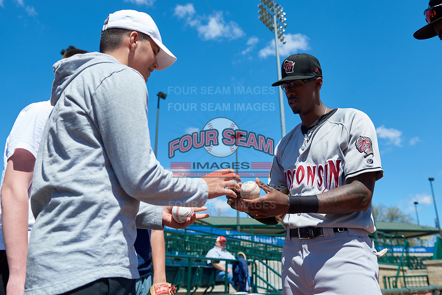 Wisconsin Timber Rattlers Je'Von Ward (4) signs an autograph before a Midwest League game against the Great Lakes Loons at Dow Diamond on May 4, 2019 in Midland, Michigan. Great Lakes defeated Wisconsin 5-1. (Zachary Lucy/Four Seam Images)