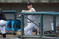 Birmingham Barons bench coach Wes Helms (18) watches the action from the dugout during the game against the Pensacola Blue Wahoos at Regions Field on July 7, 2019 in Birmingham, Alabama. The Barons defeated the Blue Wahoos 6-5 in 10 innings. (Brian Westerholt/Four Seam Images)