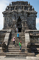 Borobudur, Java, Indonesia.  Mendut Buddhist Temple.  Indonesian Women Descending, and Taking Photos.