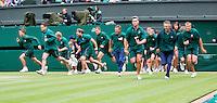 04-07-12, England, London, Tennis , Wimbledon,  Court attendants running to cover the court when it starts to rain.