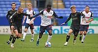 Bolton Wanderers' Arthur Gnahoua battles with Oldham Athletic's Jordan Barnett (left) and Alfie McCalmont (right) <br /> <br /> Photographer Stephen White/CameraSport<br /> <br /> The EFL Sky Bet League Two - Bolton Wanderers v Oldham Athletic - Saturday 17th October 2020 - University of Bolton Stadium - Bolton<br /> <br /> World Copyright © 2020 CameraSport. All rights reserved. 43 Linden Ave. Countesthorpe. Leicester. England. LE8 5PG - Tel: +44 (0) 116 277 4147 - admin@camerasport.com - www.camerasport.com