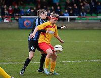 20140104 - AALTER , BELGIUM : Massenhoven's Jolien Baeten (r) pictured with defending Brugge's Heleen Jaques (l) during the female soccer match between Club Brugge Vrouwen and Massenhoven VC , of the 1/8 final matchday in the Belgian Women Cup competition. Saturday 4 January 2014 . PHOTO DAVID CATRY