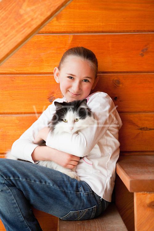 USA, Illinois, Metamora, Girl (10-11) holding cat