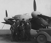 BNPS.co.uk (01202) 558833<br /> Pic: MarlowsAuctioneers/BNPS<br /> <br /> Pictured: Flight Lieutenant Maxwell Sparks being interviewed by the BBC with aircrew and a Mosquito aircraft.<br /> <br /> The medals of a hero of the legendary Operation Jericho raid who dive-bombed a Gestapo prison at just 10ft have sold for over £15,000.<br /> <br /> Flight Lieutenant Maxwell Sparks pulled off the daring manoeuvre during the daylight attack on the heavily-defended Amiens Prison in northern France in February 1944.<br /> <br /> Positioned third in the attack's first wave, he bombarded the German guards' quarters at 'tree-top height' then ascended just in time to miss the prison's roof.