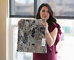 Designer Olivia Osborne shows a rug sample during Reno Magazine's Home Decor Workshop at Aspen Leaf Interiors Studio in Reno on Saturday, March 24, 2018.