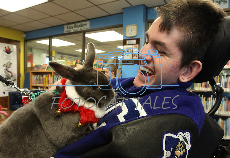 Morpheus sniffs at Jared Dempsey during a Love on A Leash event at the Carson City Library, in Carson City, Nev., on Saturday, Dec. 17, 2011. .Photo by Cathleen Allison