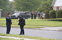 Fayetteville Police Department officials collect evidence Thursday, April 29, 2021, at 702 Daisy Lane after responding to a shooting report. A man was found in the driveway at that address with a gunshot wound. He was transported to the hospital with life threatening injuries, according to police. Visit nwaonline.com/210430Daily/ for today's photo gallery. <br /> (NWA Democrat-Gazette/Andy Shupe)