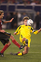 Mike Magee of the MetroStars and Mike Clark of the Crew contest for the ball. The Columbus Crew defeated the NY/NJ MetroStars 1-0 on 4/12/03 at Giant's Stadium, NJ.