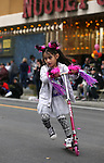 Nalani Aguilar, 5, plays on her new scooter before the start of the annual Nevada Day parade in Carson City, Nev. on Saturday, Oct. 29, 2016. <br />Photo by Cathleen Allison
