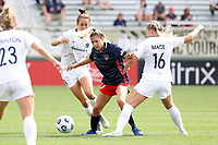 CARY, NC - APRIL 10: Ashley Sanchez #10 of the Washington Spirit is defended by Havana Solaun #19 and Hailie Mace #16 of the North Carolina Courage during a game between Washington Spirit and North Carolina Courage at Sahlen's Stadium at WakeMed Soccer Park on April 10, 2021 in Cary, North Carolina.