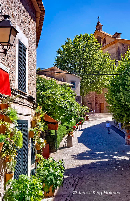 The Placa Cartoixa in central Valldemossa, looking towards the 14th Century monastic building known as the Royal Charterhouse of Jesus of Nazareth, or the Valldemossa Charterhouse where the composer Frédéric Chopin stayed in 1838-39 with his lover George Sand (Amantine Dupin).