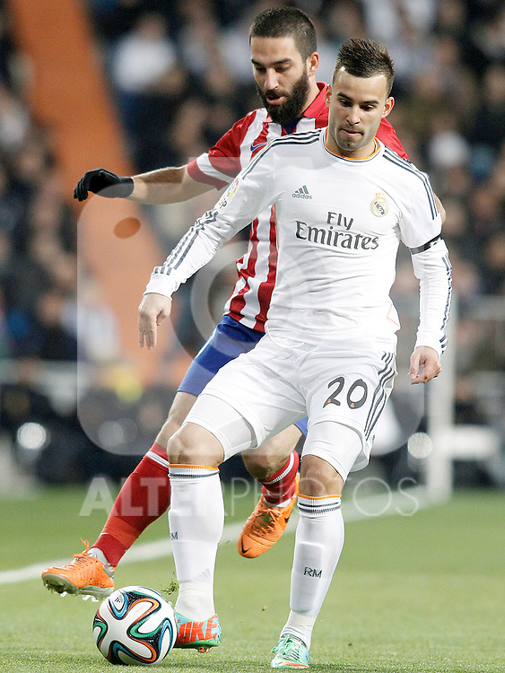 Real Madrid's Jese Rodriguez (f) and Atletico de Madrid's Arda Turan during La Copa match.February 5,2014. (ALTERPHOTOS/Acero)