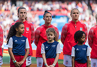 PARIS,  - JUNE 16: Tierna Davidson #12, Ali Krieger #11, and Lindsey Horan #9 stand for the national anthem during a game between Chile and USWNT at Parc des Princes on June 16, 2019 in Paris, France.