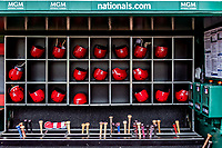 22 September 2018: A collection of the Washington Nationals batting helmets and bats are in the dugout ready to be used in a game against the New York Mets at Nationals Park in Washington, DC. The Nationals shut out the Mets 6-0 in the 3rd game of their 4-game series. Mandatory Credit: Ed Wolfstein Photo *** RAW (NEF) Image File Available ***