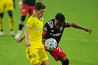 WASHINGTON, DC - OCTOBER 28: Pedro Santos #7 of Columbus Crew SC battles for the ball with Moses Nyeman #27 of D.C. United during a game between Columbus Crew and D.C. United at Audi Field on October 28, 2020 in Washington, DC.