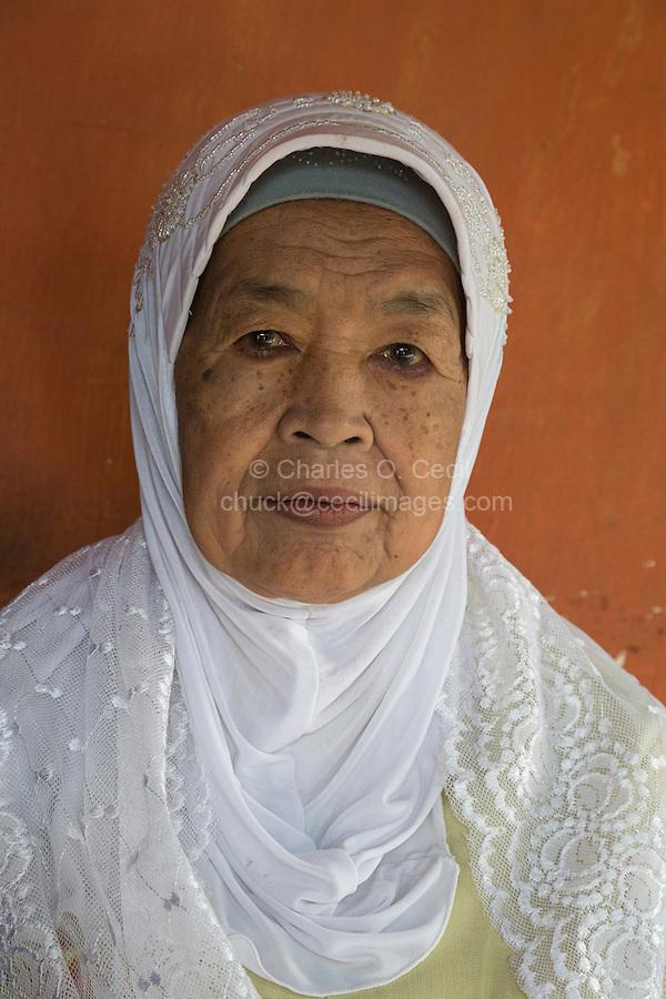 Borobudur, Java, Indonesia.  Elderly Rural Javanese Woman in Headscarf.