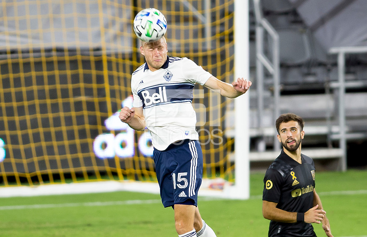 LOS ANGELES, CA - SEPTEMBER 23: Andy Rose #15 of the Vancouver Whitecaps with a head ball during a game between Vancouver Whitecaps and Los Angeles FC at Banc of California Stadium on September 23, 2020 in Los Angeles, California.