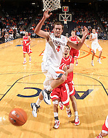 Dec. 07, 2010; Charlottesville, VA, USA;  Virginia Cavaliers forward Will Regan (4) is fouled on the way to the basket during the game against the Radford Highlanders at the John Paul Jones Arena. Virginia won 54-44. Mandatory Credit: Andrew Shurtleff