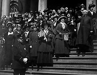 """Members of the """"Liberty Loan Choir"""" singing on the steps of City Hall, New York City, in the third Liberty Loan campaign.  At the right is Bishop William Wilkinson, who led the choir.  April 1918.  Paul Thompson.  (Army)<br /> Exact Date Shot Unknown<br /> NARA FILE #:  111-SC-16561<br /> WAR & CONFLICT BOOK #:  514"""