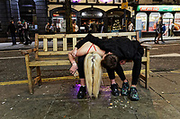 Pictured: A young man and a woman on a bench in Swansea. Tuesday 31 December 2019 to Wednesday 01 January 2020<br /> Re: Revellers on a night out for New Year's Eve in Wind Street, Swansea, Wales, UK.