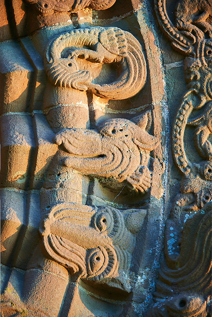 Norman Romanesque relief sculptures of dragons and mythical creatures from the South doorway of Church of St Mary and St David, Kilpeck Herifordshire, England. Built around 1140