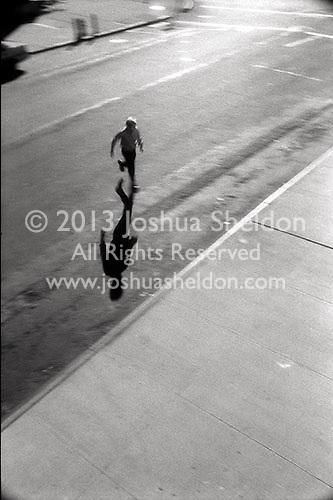 Man running across city street&#xA;<br />