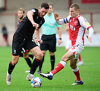 Lincoln City's Tom Hopper vies for possession with Fleetwood Town's Paul Coutts<br /> <br /> Photographer Chris Vaughan/CameraSport<br /> <br /> The EFL Sky Bet League One - Fleetwood Town v Lincoln City - Saturday 17th October 2020 - Highbury Stadium - Fleetwood<br /> <br /> World Copyright © 2020 CameraSport. All rights reserved. 43 Linden Ave. Countesthorpe. Leicester. England. LE8 5PG - Tel: +44 (0) 116 277 4147 - admin@camerasport.com - www.camerasport.com