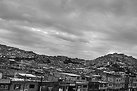 Ciudad Bolívar, a shanty town in the south of Bogota, where internally displaced people from all over the country live, Colombia, 23 May 2009. With nearly fifty years of armed conflict, Colombia has the highest number of civil war refugees in the world. During the last ten years of the civil war more than 3 million people have been forced to abandon their lands and to leave their homes due to the violence. Internally displaced people (IDPs) come from remote rural areas, where most of the clashes between leftist guerrillas FARC-ELN, right-wing paramilitary groups and government forces takes place. Displaced persons flee in a hurry, carrying just personal belongings, and thus they inevitably end up in large slums of the big cities, with no hope for the future.