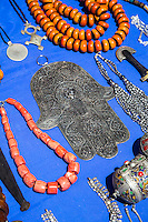 Essaouira, Morocco.  Hand of Fatima Displayed on the Sidewalk, with other jewelry, for sale in the medina.
