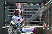 Hitting coach Lee May (31) of the Greenville Drive wipes his brow with a towel in 95-degree weather during a game against the Augusta GreenJackets on Sunday, June 12, 2016, at Fluor Field at the West End in Greenville, South Carolina. Greenville won, 11-8. (Tom Priddy/Four Seam Images)