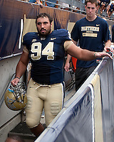 Pitt defensive tackle Myes Caragein leaves the field following the Pitt victory. The Pittsburgh Panthers defeat the New Hampshire Wildcats 38-16 at Heinz Field, Pittsburgh Pennsylvania on September 11, 2010.