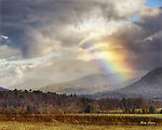 """A colorful """"sun dog"""" provides a peaceful contrast to angry storm clouds over Cades Cove in this HDR image."""