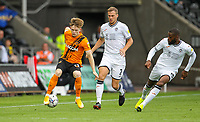 11th September 2021; Swansea.com Stadium, Swansea, Wales; EFL Championship football, Swansea versus Hull City; Keane Lewis-Potter of Hull City controls the ball while under pressure from Ryan Bennett and Olivier Ntcham of Swansea City
