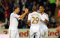 """Pictured: Luke Moore of Swansea (R) celebrating his goal, with team mates Stephen Dobbie and Ashley """"Jazz"""" Richards. Tuesday 28 August 2012<br /> Re: Capital One Cup game, Swansea City FC v Barnsley at the Liberty Stadium, south Wales."""